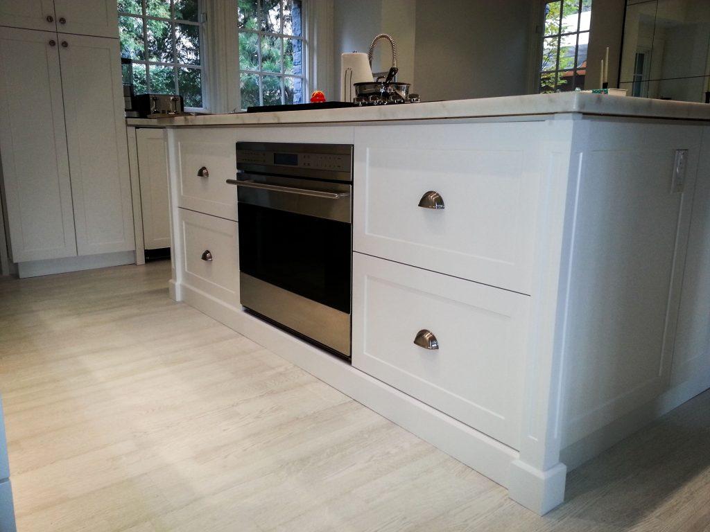 white kitchen cabinets built by design