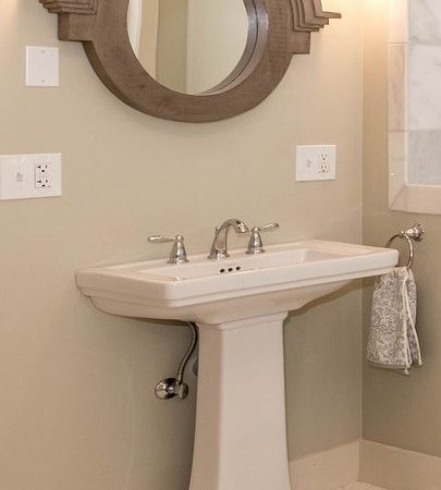 pedestal sink installed in bathroom