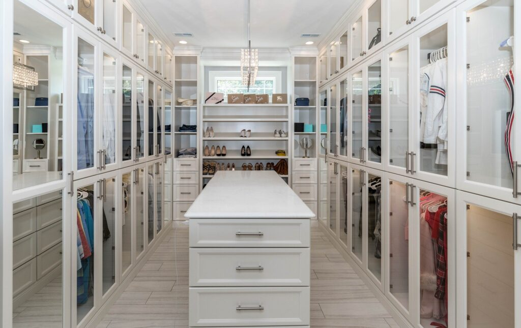 beautiful custom closet room with cabinets doors glass king city