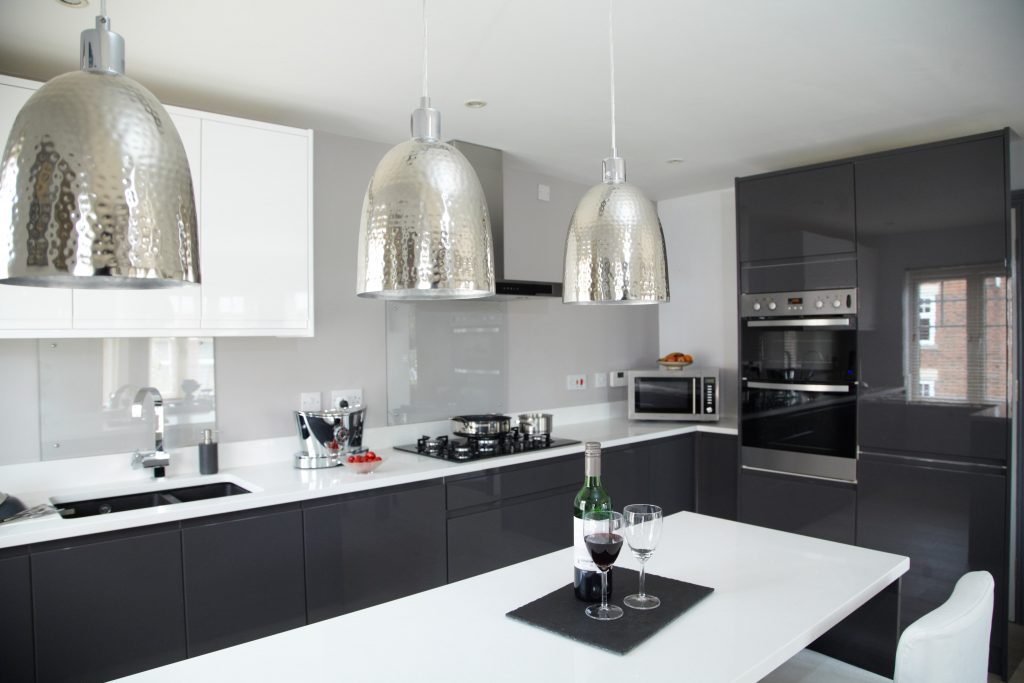 custom kitchen design with two tone black and white cabinets