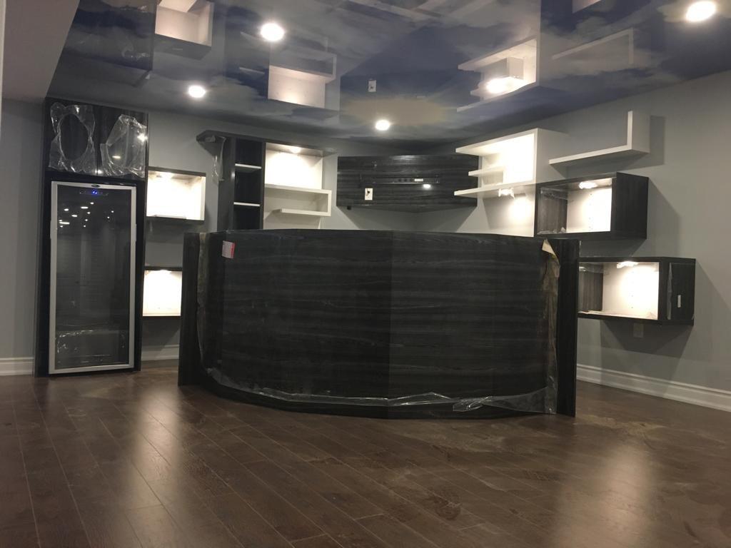 luxury basement bar - cabinets for a bar