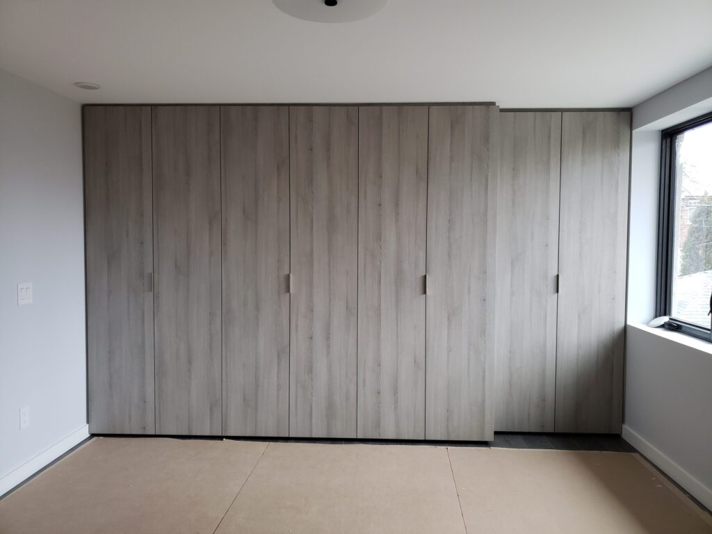 large wall closet for storage - cabinets designs by clearview kitchen