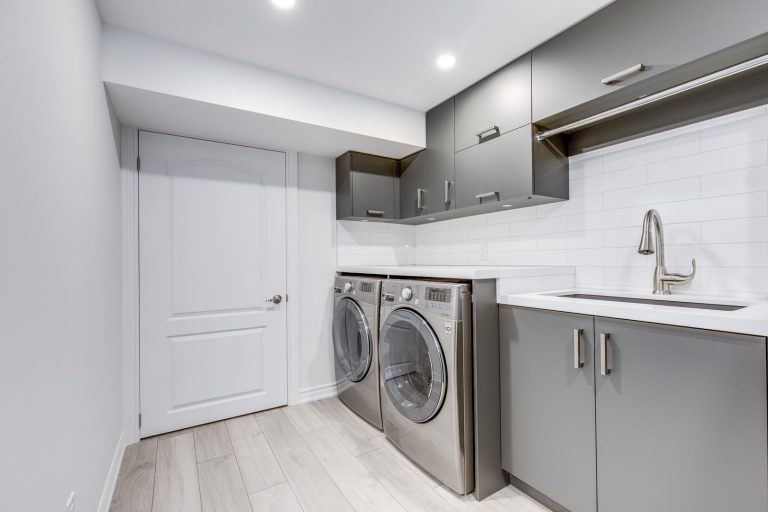 luxury laundry room with storage cabinets - cabinets for laundry room