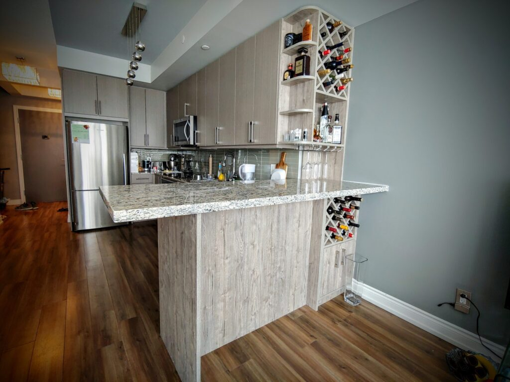 custom kitchen in condo with wine shelves - custom shelving units