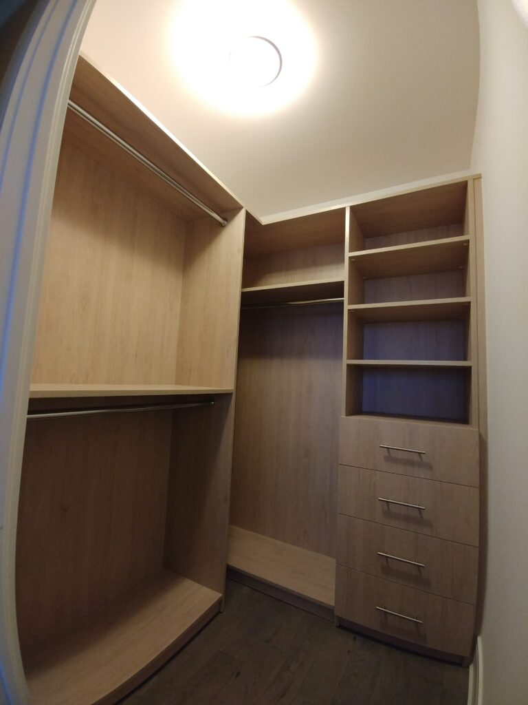 custom closet in the basement -custom cabinetry aurora