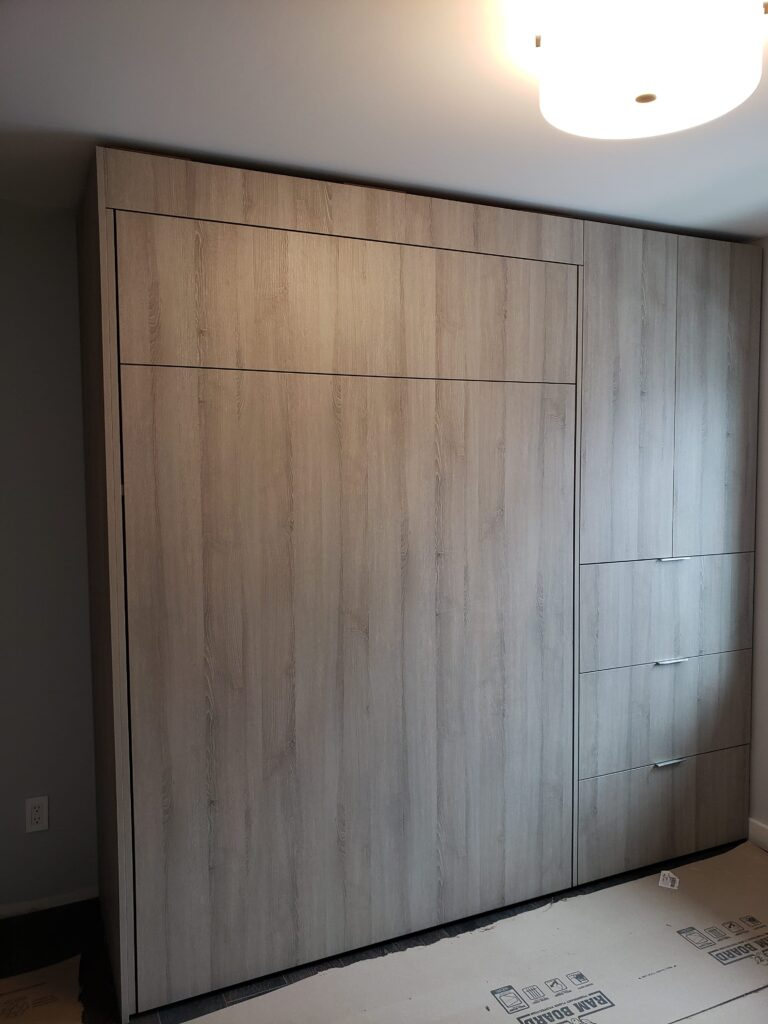 bedroom with Storage unit and hidden bed in the closet by clearview kitchen