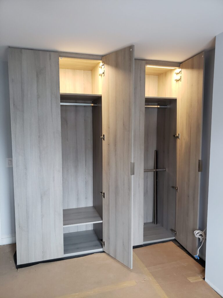 small storage closet with light in the top shelve - cabinets toronto