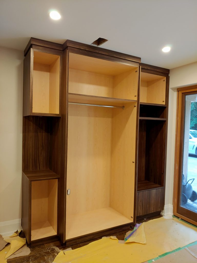 in progress of assembly custom storage unit - cabinets install whitchurch