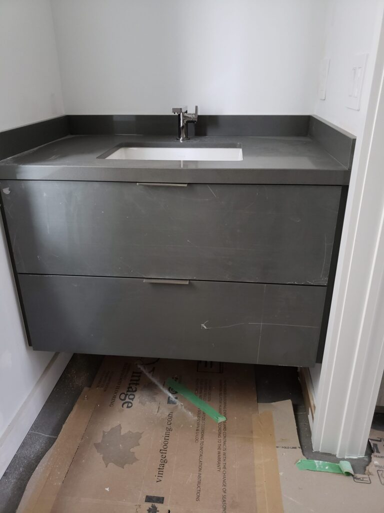 in progress of installing vanity in luxury bathroom - cabinets for bathroom vanities