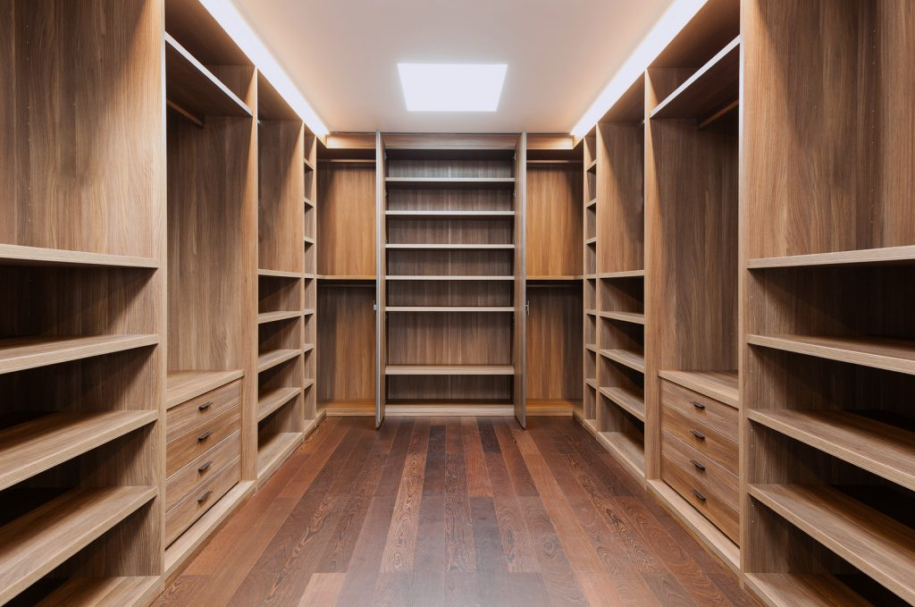 room filed with wardrobe shelving units - custom cabinetry