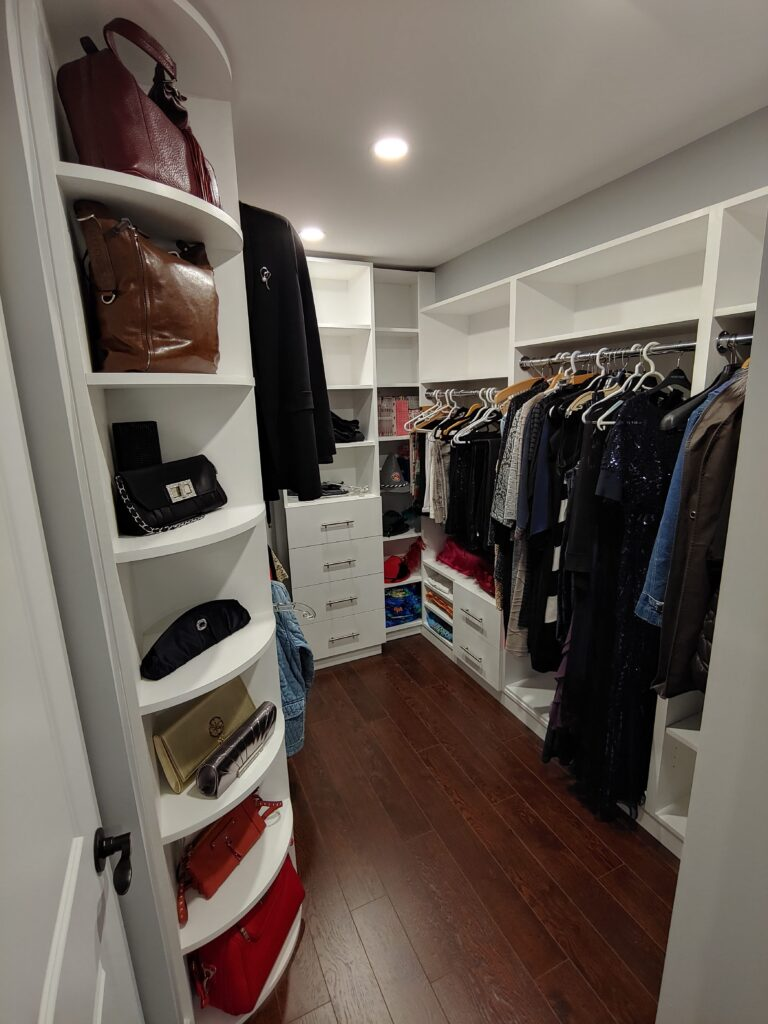 custom wardrobe cabinets in the basement - closets manufacturing