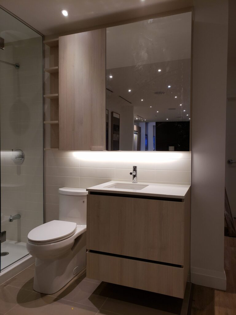 small bathroom with back lit custom cabinets thornhill