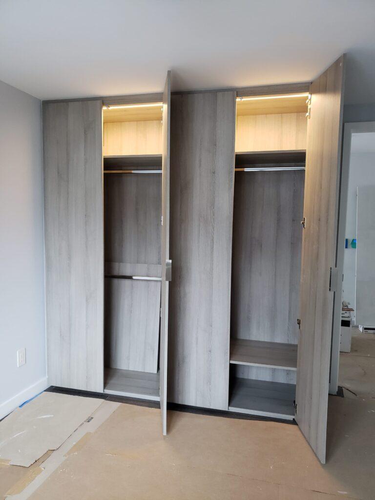 custom small storage space with back light - custom shelving units maple