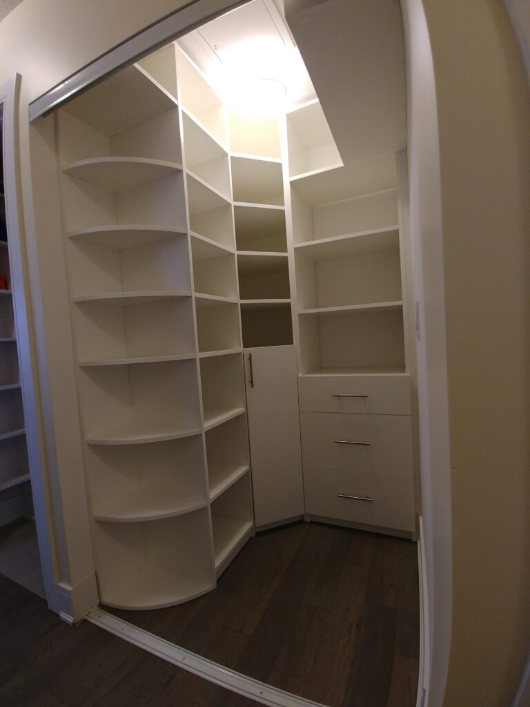 white modern wardrobe cabinets in the basement-custom shelving units toronto