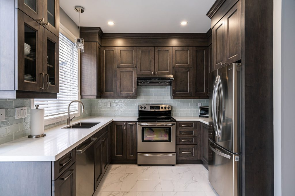 custom  kitchen with brown kitchen cabinets and marble floor - kitchen remodeling
