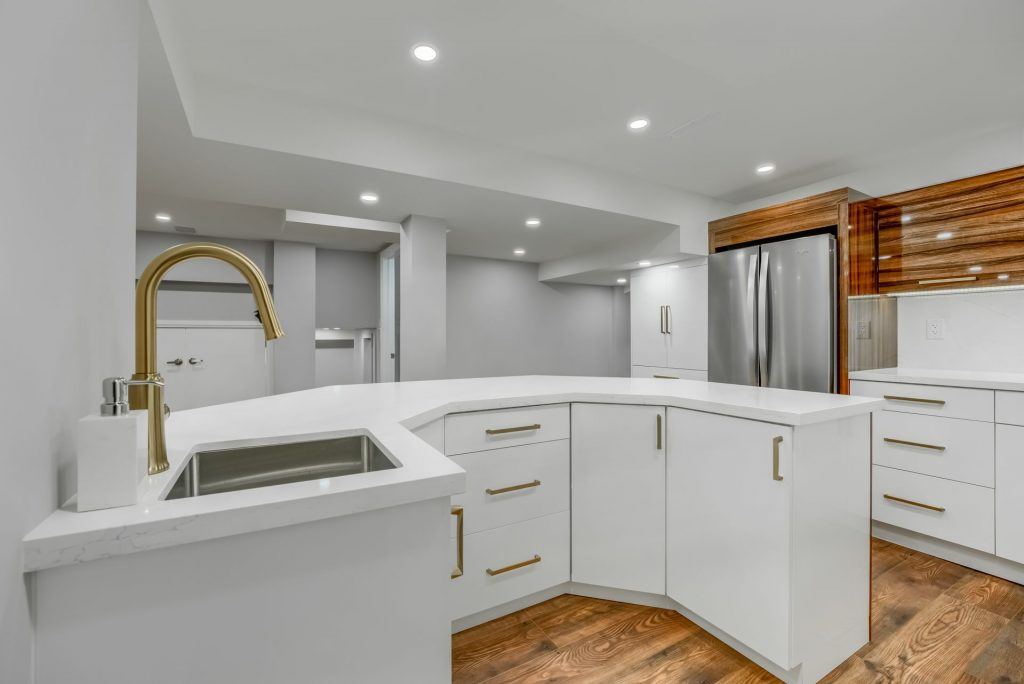 Scarborough basement wet bar with white kitchen cabinets