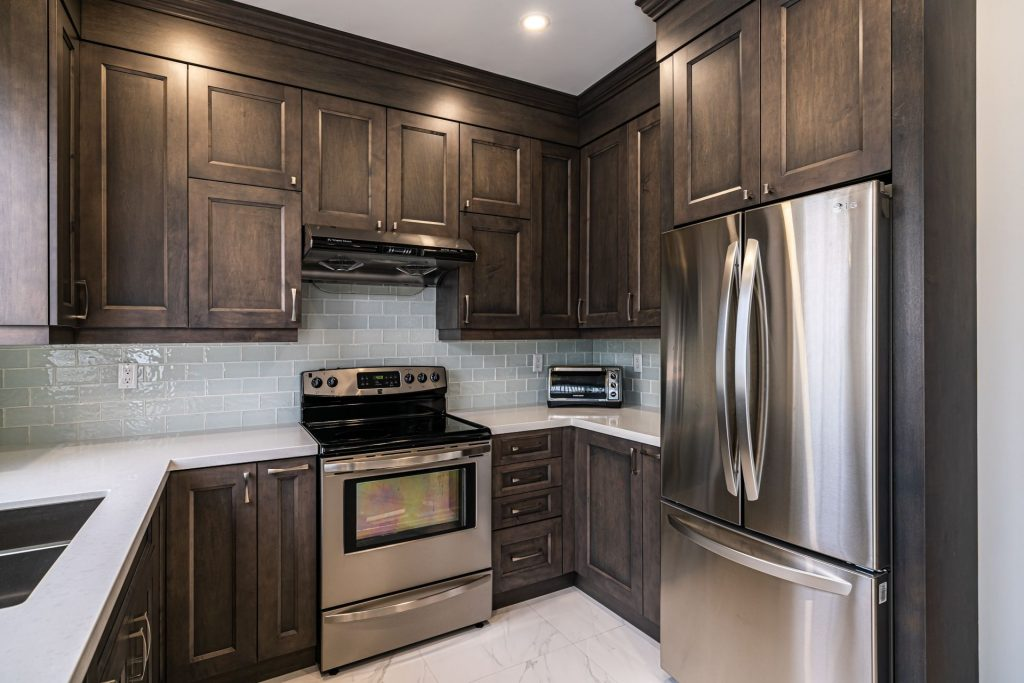 small kitchen with brown wooden cabinets - kitchen cabinetry