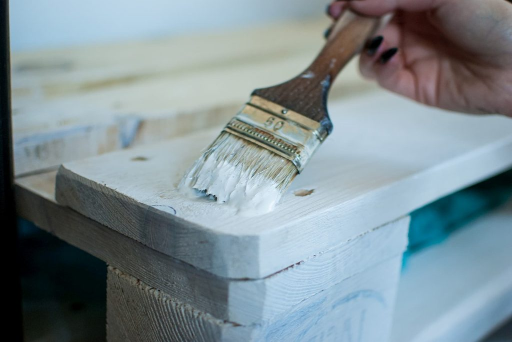 photo of wood painting with a brush
