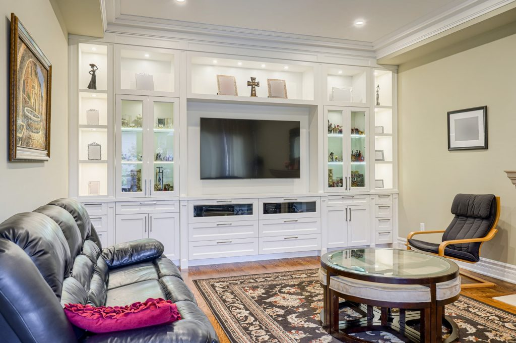 amazing family room with backlit cabinets and crown moudling trim – renovation company GTA