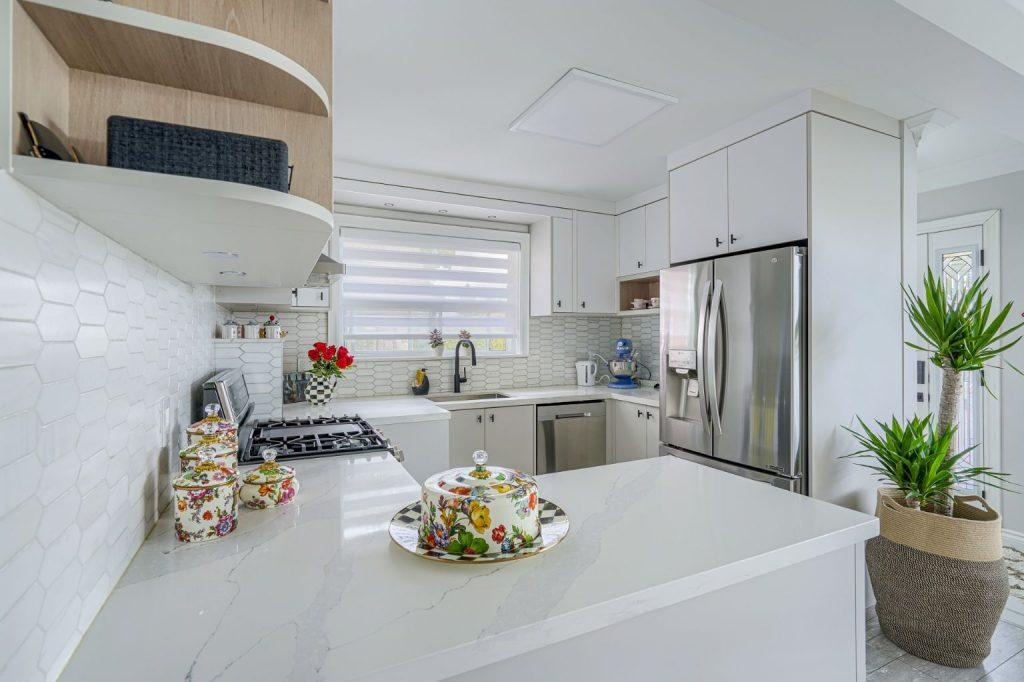 Kitchen peninsula with white kitchen cabinets