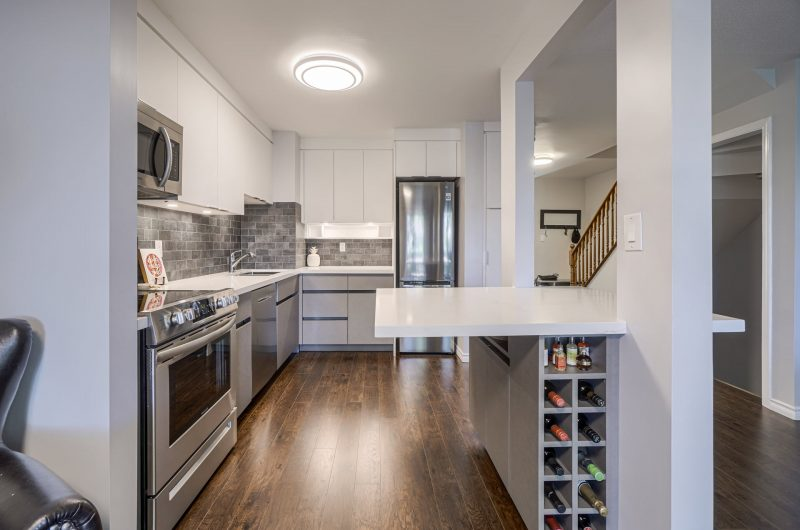 photo of amazing kitchen cabinets with wine shelves and build in appliances - kitchen refacing by clear view kitchens toronto