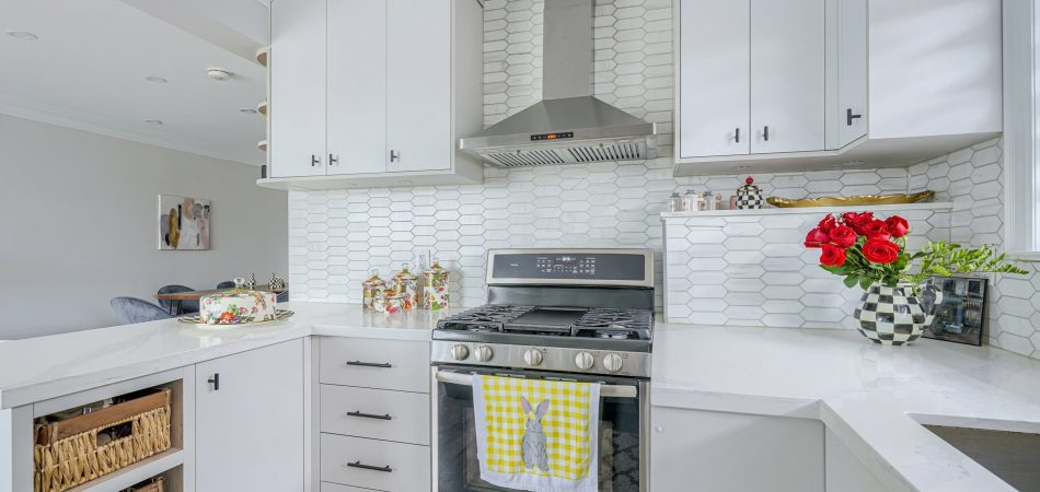 photo of amazing kitchen with potlights and white backlit kitchen cabinets - kitchen companies vaughan