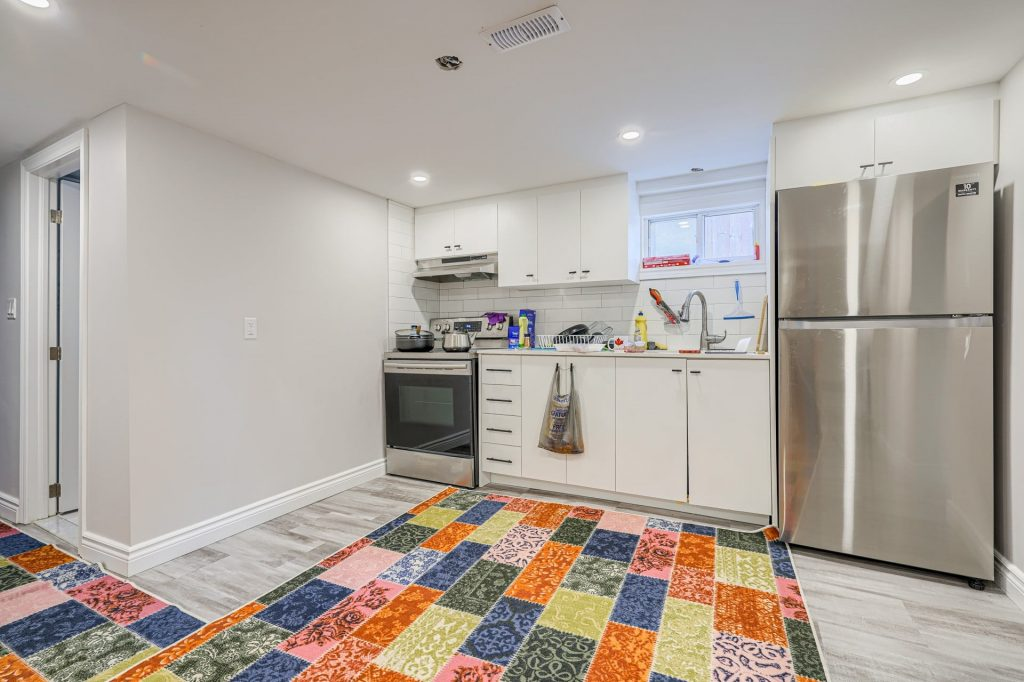 small basement kitchen with baseboard trim and white kitchen cabinets - kitchen renovation by clearview kitchens