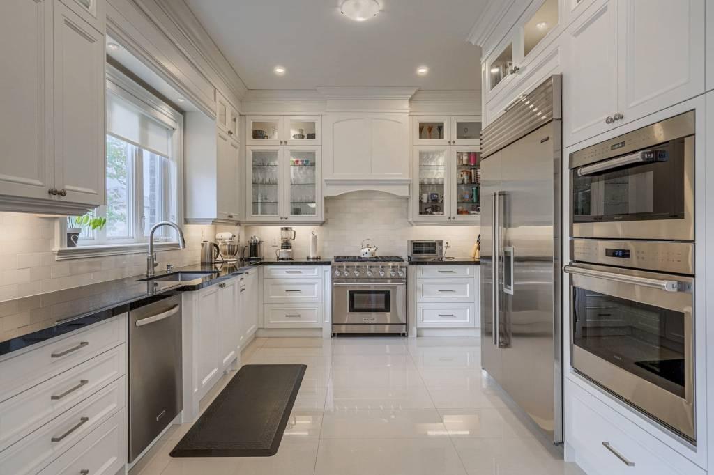 Kitchen with white custom kitchen cabinets in Toronto