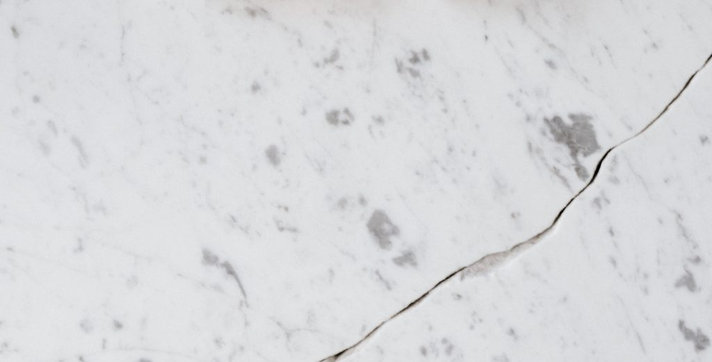 photo of marble counter top with crack