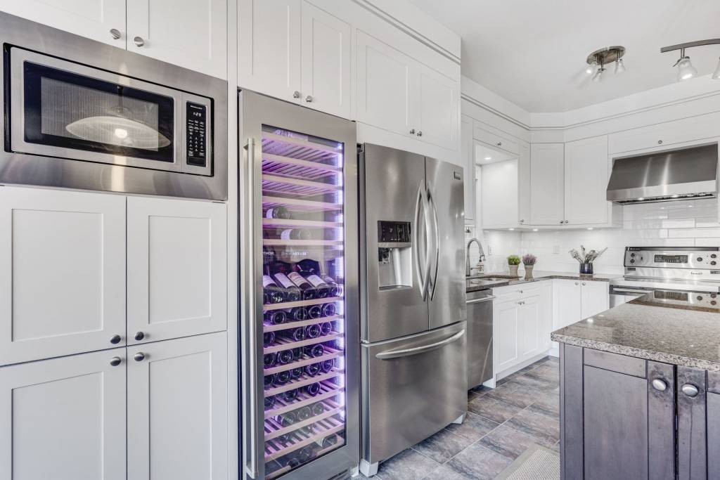 wine cooler with backlit shelves in custom kitchen cabinets
