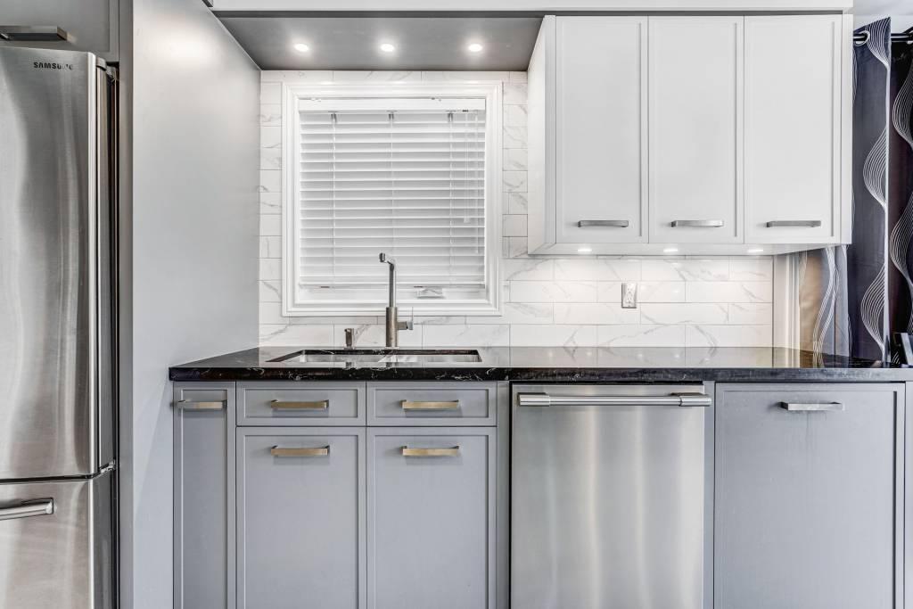 custom backlit white and gray kitchen cabinets - custom kitchen design
