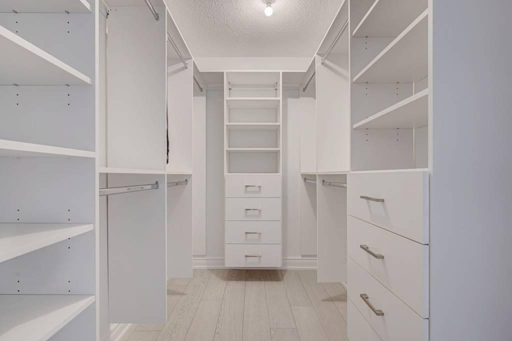 walk in closet with custom cabinets - custom closet shelving