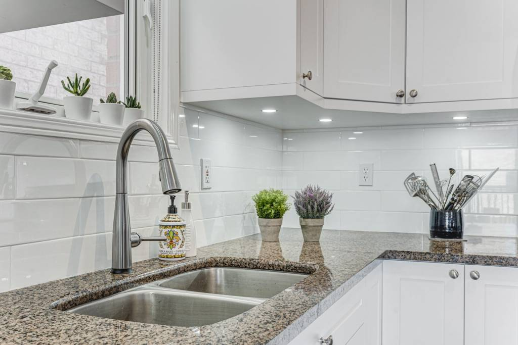 white brick splash wall and double sink in kitchen renovation toronto