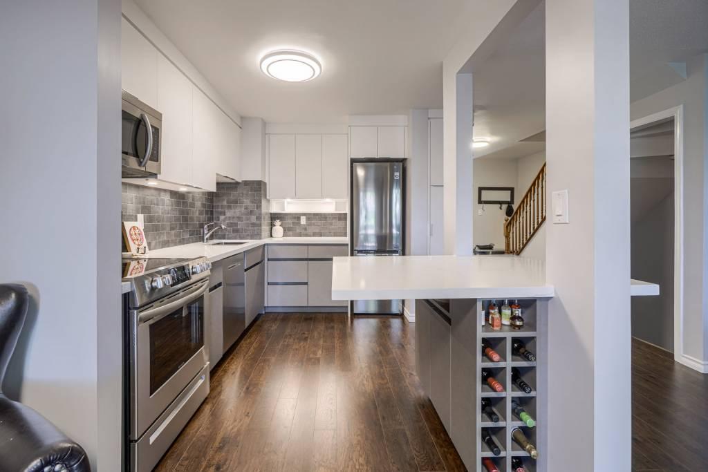 Modern Kitchen Design with Custom Wine Shelves Scarborough